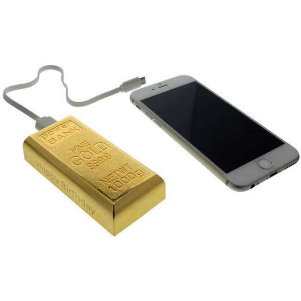 Powerbank als Goldbarren mit USB Kabel und Smartphone